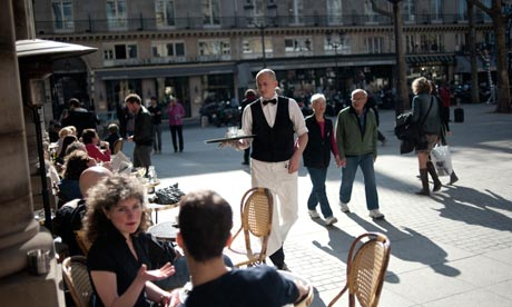 People sit a a cafe terrace on March 15,   Nick Cohen: Writing ...