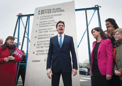 Labour leader Ed Miliband unveils Labour's pledges carved into a stone plinth in Hastings during General Election campaigning.