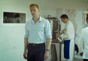 WARNING: Embargoed for publication until 00:00:01 on 22/03/2016 - Programme Name: The Night Manager - TX: 27/03/2016 - Episode: The Night Manager (No. Ep 6) - Picture Shows: *STRICTLY NOT FOR PUBLICATION UNTIL 00:01HRS, TUESDAY 22ND MARCH, 2016* Jonathan Pine (TOM HIDDLESTON), Supporting Artists - (C) The Ink Factory - Photographer: Des Willie