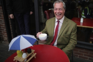 SHEFFIELD, ENGLAND - MAY 25:  Leader of the United Kingdom Independence Party (UKIP), Nigel Farage drinks coffee outside a cafe during campaigning for votes to leave the European Union on May 25, 2016 near Sheffield, England. Nigel Farage took his battle bus to Chapeltown, near Sheffield, encouraging British people to vote to leave the EU in the June 23rd referendum.  (Photo by Christopher Furlong/Getty Images)
